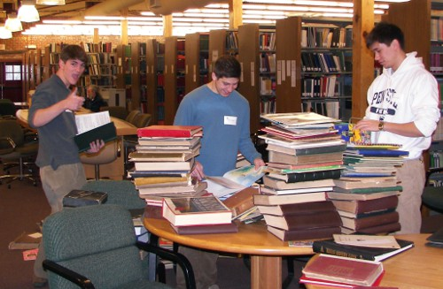 Volunteers sort albums in the Library