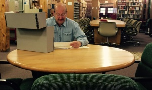 A researcher studies archival material in the library